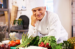 Happy cook in his kitchen