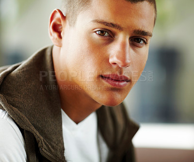 Buy stock photo Portrait of smart young guy looking confidently