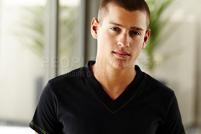 Buy stock photo Handsome young guy standing confidently