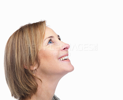 Buy stock photo Pretty happy mature woman looking at the corner on