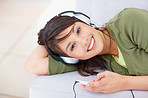 Cute female listening to music on  mp3 player