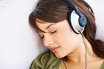 Young female fallen asleep while listening to music