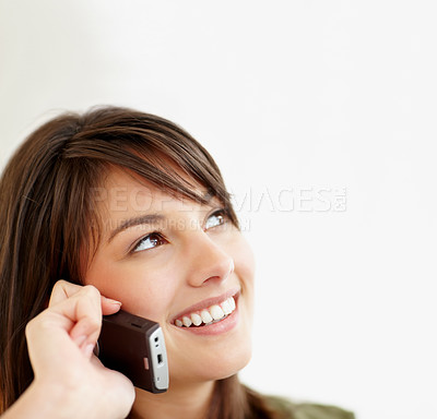 Buy stock photo Lovely female speaking on the mobile , looking awa