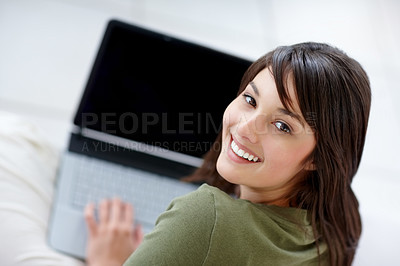 Buy stock photo Attractive young female using a laptop