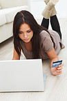 Closeup portrait of a young lady shopping on internet