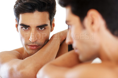 Buy stock photo Closeup portrait of a handsome young man gazing at you in the mirror