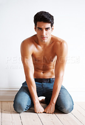 Buy stock photo Portrait of a shirtless young man sitting on the floor - Copyspace