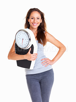 Buy stock photo Happy woman holding a scale against white background
