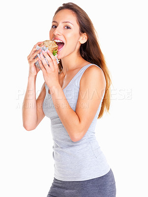 Buy stock photo Side view of woman biting a sandwich