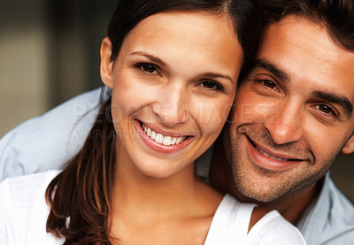Buy stock photo Attractive couple smiling while embracing