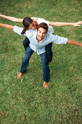 Buy stock photo Pretty woman balancing on mans back