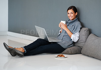 Buy stock photo Pretty woman with her cup of coffee and laptop sitting on the floor