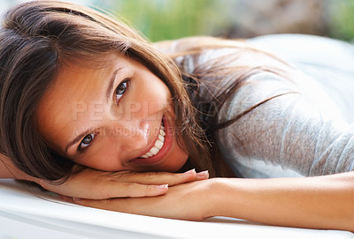 Buy stock photo Playful woman lying down and smiling