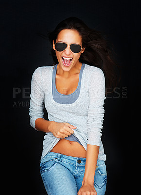 Buy stock photo Sexy woman wearing sunglasses against black background