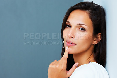 Buy stock photo Pretty woman looking contemplative against blue background