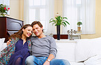 A yonng couple in thier fashionable home.