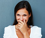 Shy woman with hand over mouth