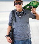 Young male holding skateboard