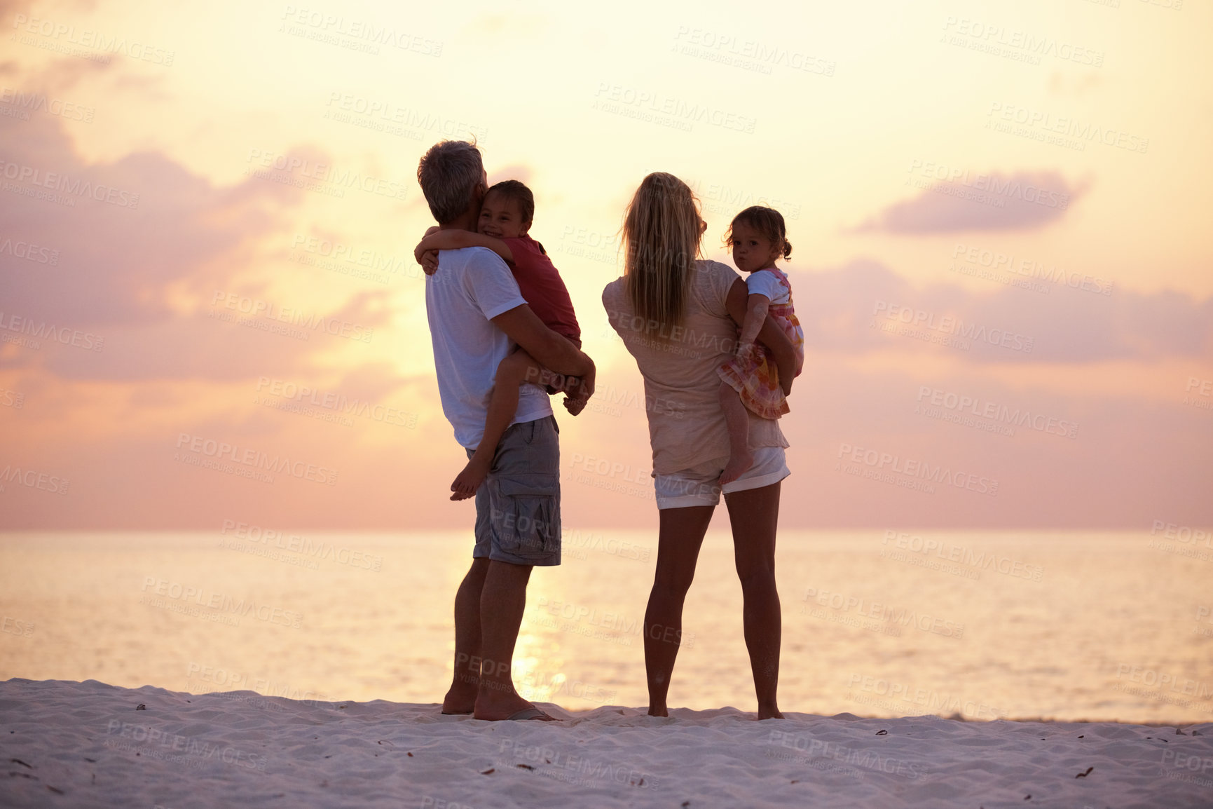 Buy stock photo Portrait of parents with their daughters on the beach