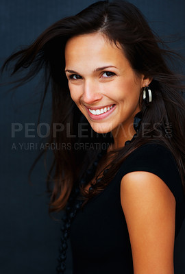 Buy stock photo Woman looking directly into camera with windswept hair