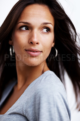 Buy stock photo Closeup portrait of a beautiful young lady looking away in thought