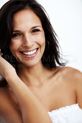 Buy stock photo Portrait of a sexy young woman looking happy against white background