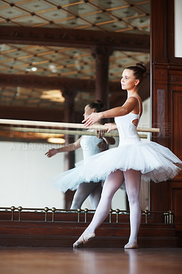 Buy stock photo Full length of a young beautiful ballerina practicing with mirror in background