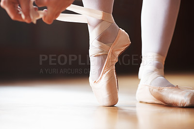 Buy stock photo Closeup portrait of a ballerina preparing to go en pointe