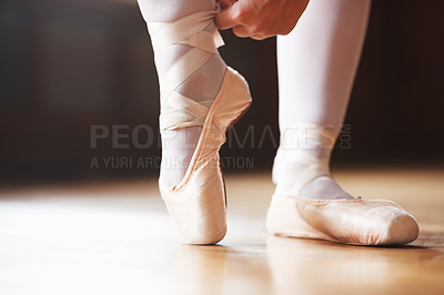Buy stock photo Closeup portrait of a ballerina puts on Pointe