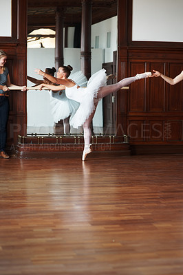 Buy stock photo Portrait of a ballerina undergoing training with trainers in front of mirror
