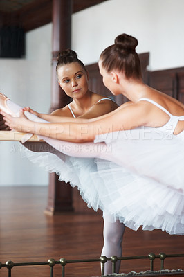 Buy stock photo Portrait of a ballerina in front of a mirror