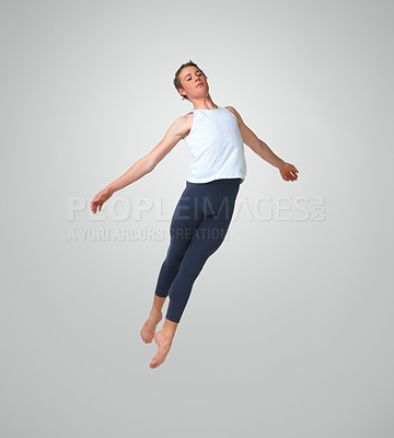 Buy stock photo Full length of a male ballet dancer jumping against white background - copyspace