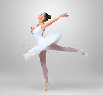 Buy stock photo Full length of a young and beautiful ballet dancer practicing against white background