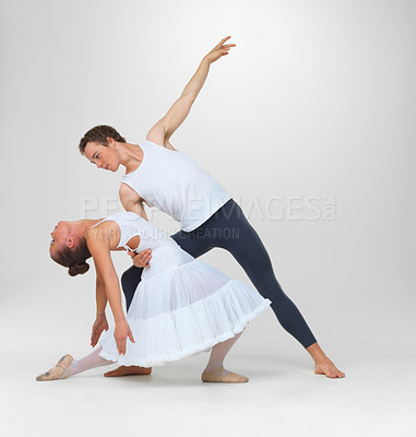 Buy stock photo Portrait of two ballet dancers performing against white background - copyspace