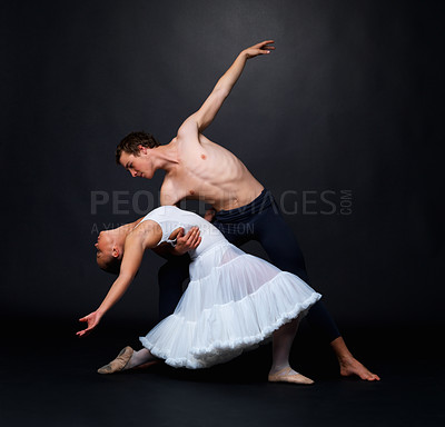 Buy stock photo Full length of two ballet dancers performing against black background