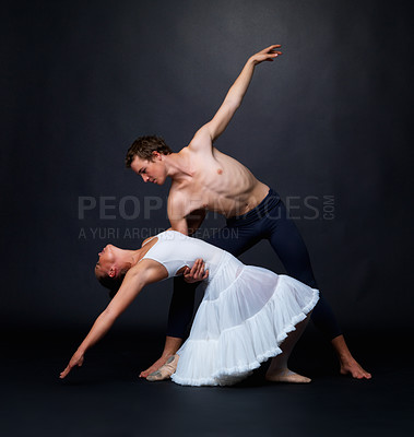 Buy stock photo Full length of two graceful dancers performing against black background