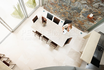 Buy stock photo Top view of a woman sitting in a modern dining room