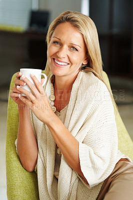Buy stock photo Closeup portrait of a pretty middle-aged woman with a cup of coffee smiling