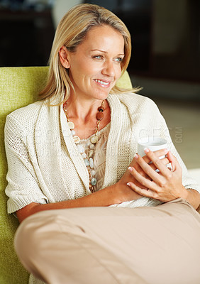 Buy stock photo Closeup portrait of a thoughtful mature woman holding a cup of tea or coffee