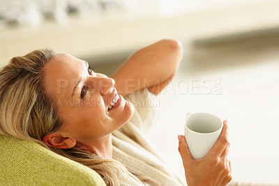Buy stock photo Detail shot of a smiling middle aged woman with a cup of tea or coffee looking up