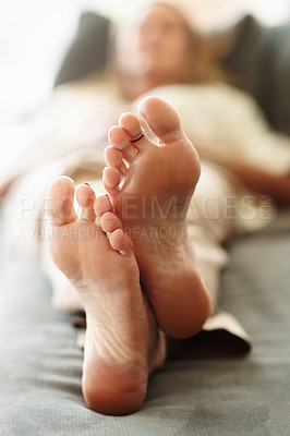 Buy stock photo Macro view of woman's feet resting in bed