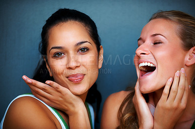 Buy stock photo Closeup portrait of beautiful teenagers making funny expression against grey background