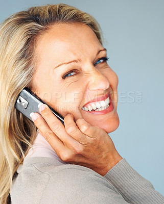 Buy stock photo Closeup portrait of a happy woman using a cellphone while giving you a smile