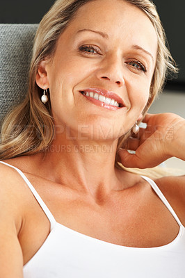 Buy stock photo Closeup of a happy relaxed mid adult woman smiling
