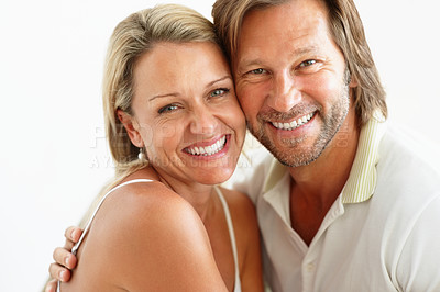Buy stock photo Closeup portrait of a sweet loving couple smiling together against white background