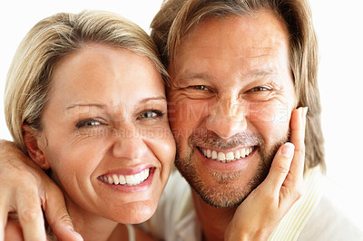 Buy stock photo Closeup of a happy loving couple smiling together against white background