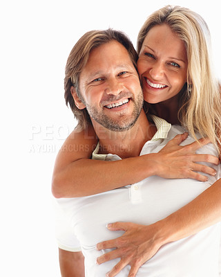 Buy stock photo Portrait of a loving man carrying a woman on his back against white background