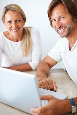 Buy stock photo Closeup portrait of a smiling mature using a laptop together