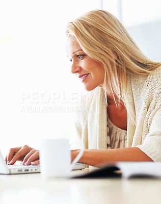 Buy stock photo Portrait of a mature woman working on a laptop against white background