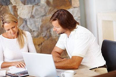 Buy stock photo Portrait of a mature couple doing home finance at dining table , using laptop